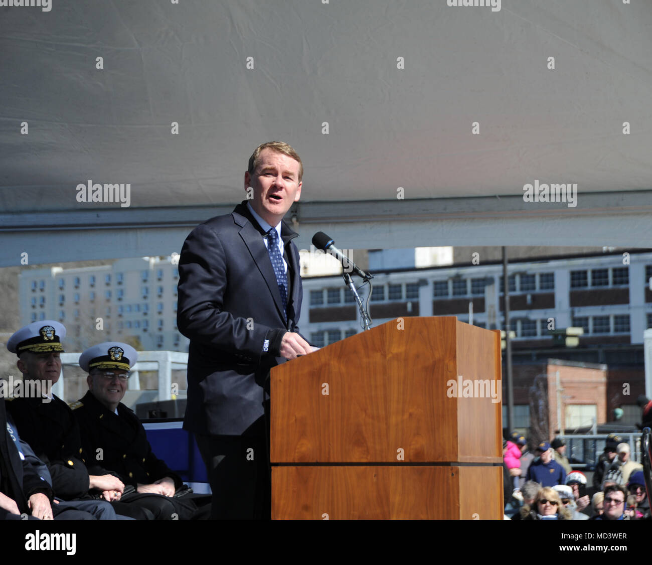 GROTON, Conn. (Mar. 17, 2018) The Honorable Michael F. Bennet, United States Senator, offers remarks at the commissioning ceremony for USS Colorado (SSN 788) on March 17, 2018. Colorado is the the U.S. Navy's 15th Virginia-class attack submarine and the fourth US Navy ship named for the State of Colorado.  (U.S. Navy photo by Chief Petty Officer Darryl I. Wood/Released) Stock Photo