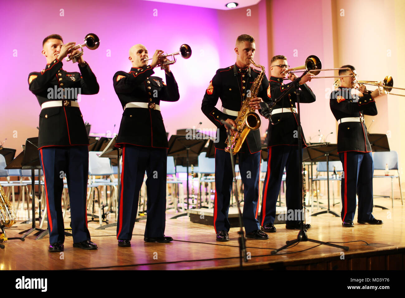 Marines with the 3rd Marine Aircraft Wing's brass band perform at the University of Pittsburgh prior to the Pittsburgh St. Patrick's Day Parade, March 16. The 3rd MAW band's presence at high-visibility events allows positive interaction with the public and assists in recruiting efforts across the country. (U.S. Marine Corps photo by Sgt. David Bickel/Released) Stock Photo