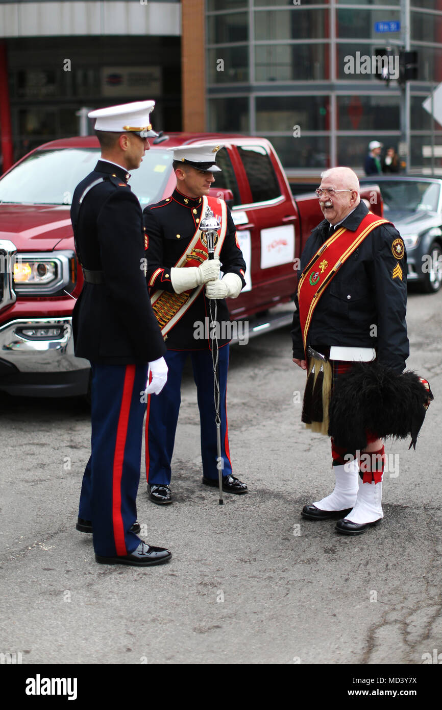 Marines with the 3rd Marine Aircraft Wing band interact with parade participants prior to the Pittsburgh St. Patrick's Day Parade, March 17. The 3rd MAW band's presence at high-visibility events allows positive interaction with the public and assists in recruiting efforts across the country. (U.S. Marine Corps photo by Sgt. David Bickel/Released) Stock Photo