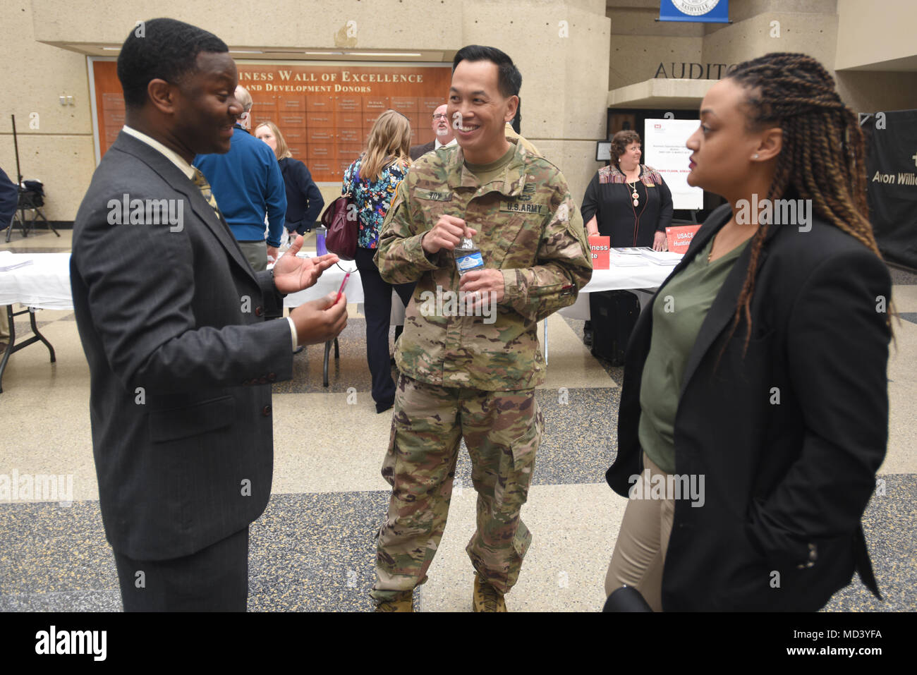 Brig. Gen. Mark Toy, U.S. Army Corps of Engineers Great Lakes and Ohio River Division commander, meets with Christopher Ballard, vice president of operations for Simms Building Group, and Endia Javon, administrative assistant and project administrator for Simms Building Group, during the Business Opportunities Open House, also known as 'BOOH,' at Tennessee State University in Nashville, Tenn., March 15, 2018. (USACE photo by Leon Roberts) - Stock Image