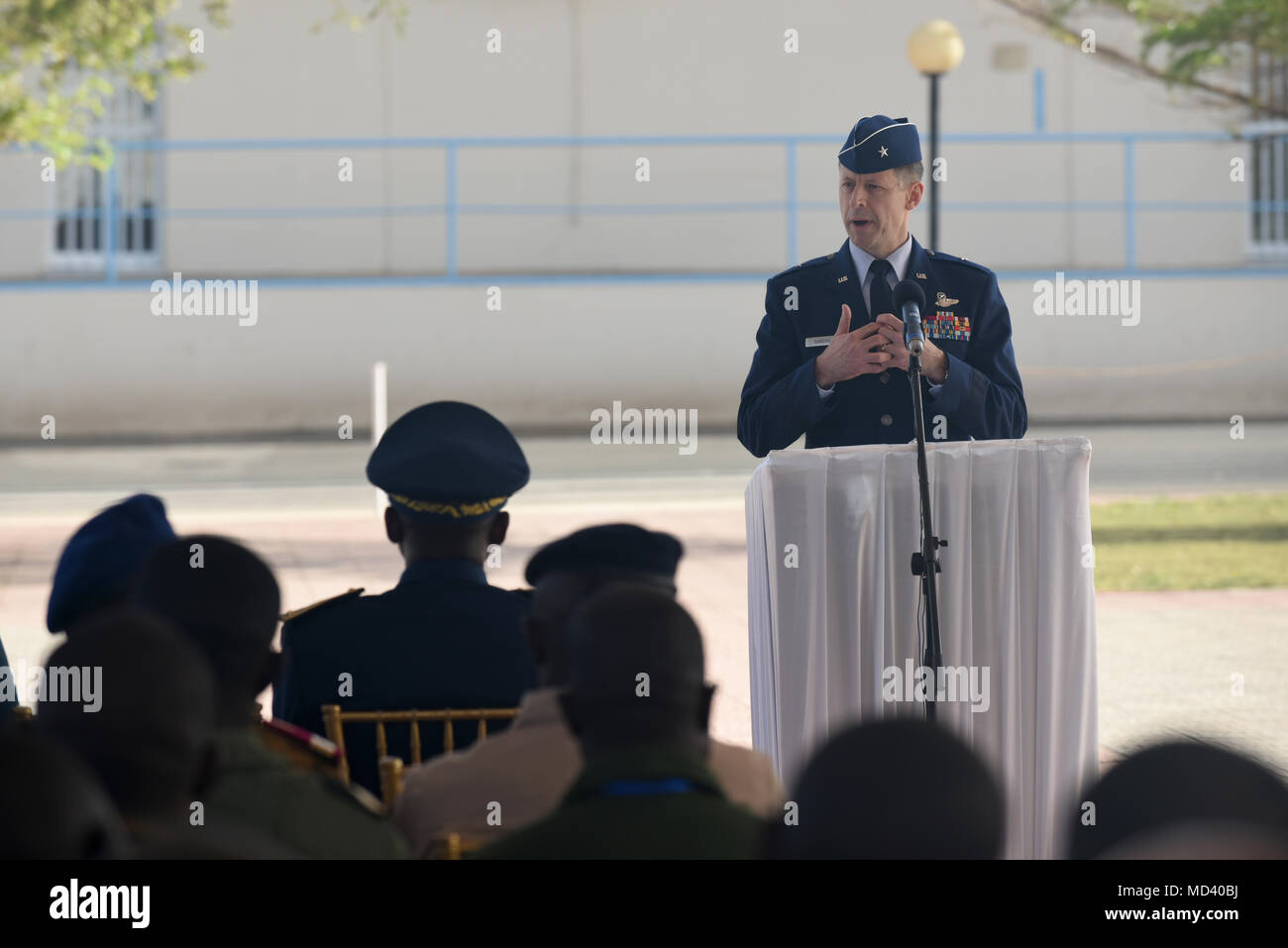 U.S. Air Force Brig. Gen. Dieter Bareihs, U.S. Air Forces in Africa director of plans, programs and analyses, speaks during the opening ceremony of African Partnership Flight Senegal at Captain Andalla Cissé Air Base, Senegal, March 19, 2018. The APF program is U.S. Air Forces in Africa's premier security cooperation program with African partner nations to improve professional military aviation knowledge and skills. (U.S. Air Force photo by Airman 1st Class Eli Chevalier) - Stock Image