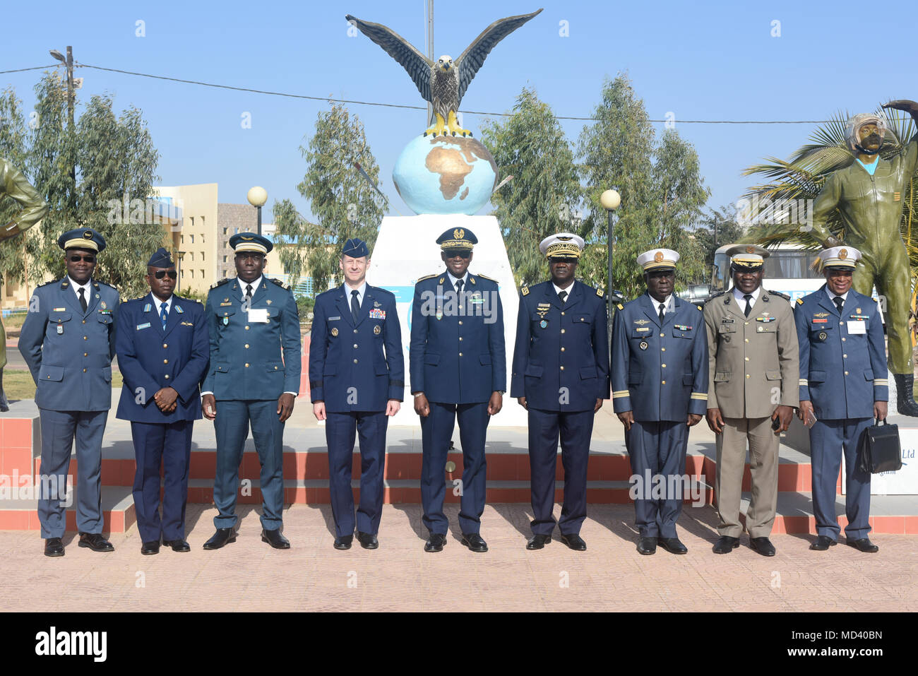 Distinguished visitors from participating African countries pose for a photo after the opening ceremony of African Partnership Flight Senegal at Captain Andalla Cissé Air Base, Senegal, March 19, 2018.  The purpose of APF Senegal is to conduct multilateral, military-to-military engagements and security assistance with African air forces. (U.S. Air Force photo by Airman 1st Class Eli Chevalier) - Stock Image