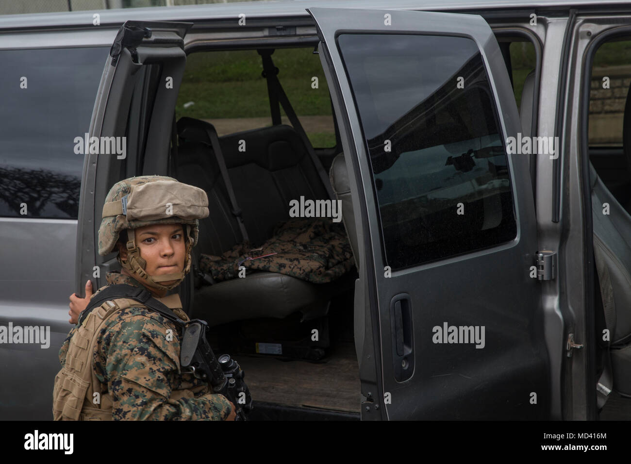 A U.S. Marines with Marine Air Ground Task Group 24 conducts a vehicle inspection for a base defensive exercie aboard Marine Corps Air Station Kaneohe Bay, Mar. 14, 2018. The exercise was conducted to ensure proper measures are taken in the event that a threat arises at the air station. (U.S. Marine Corps photo by Sgt. Alex Kouns) - Stock Image