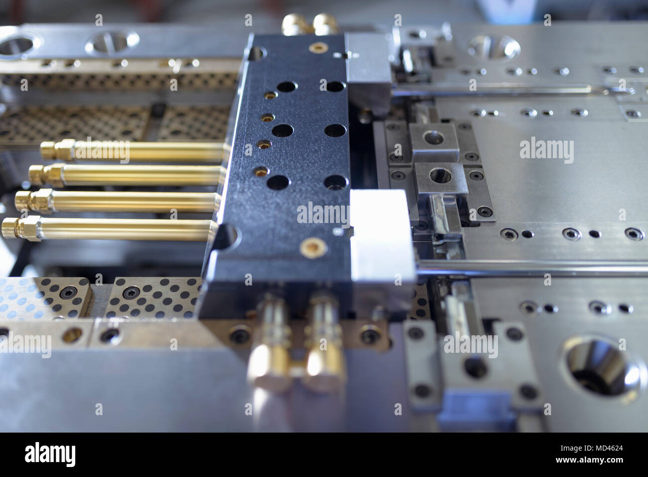 Detail of plastic injection mould in precision engineering factory - Stock Image