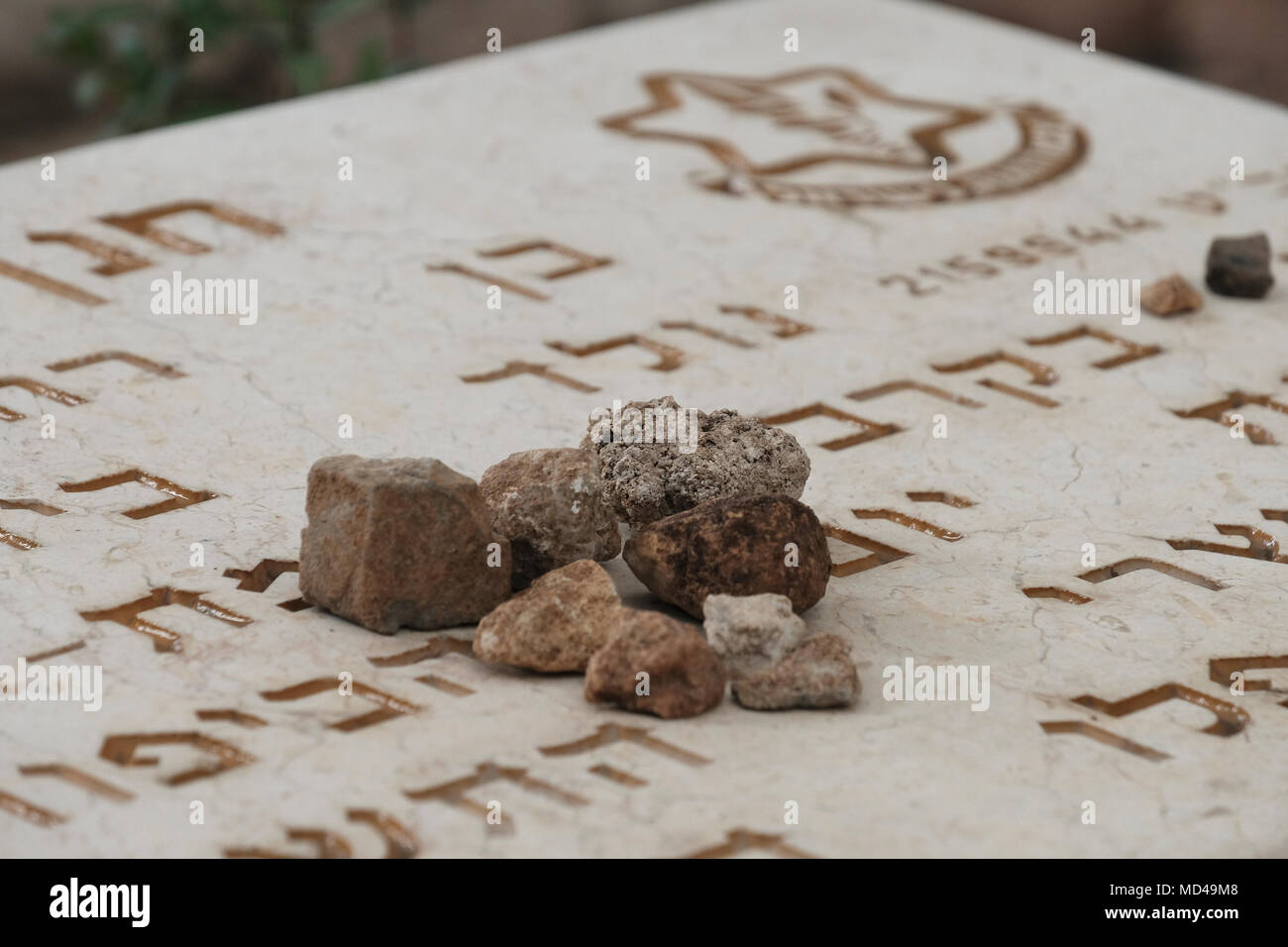 Small Pieces Of Stone Are Seen Over The Grave Of An Israeli Fallen