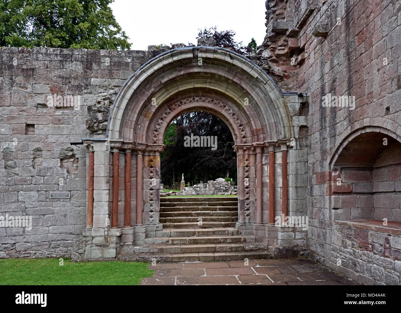 Detail of Romanesque doorway. Dryburgh Abbey. Dryburgh, St.Boswells, Roxburghshire, Scottish Borders, Scotland, United Kingdom, Europe. - Stock Image