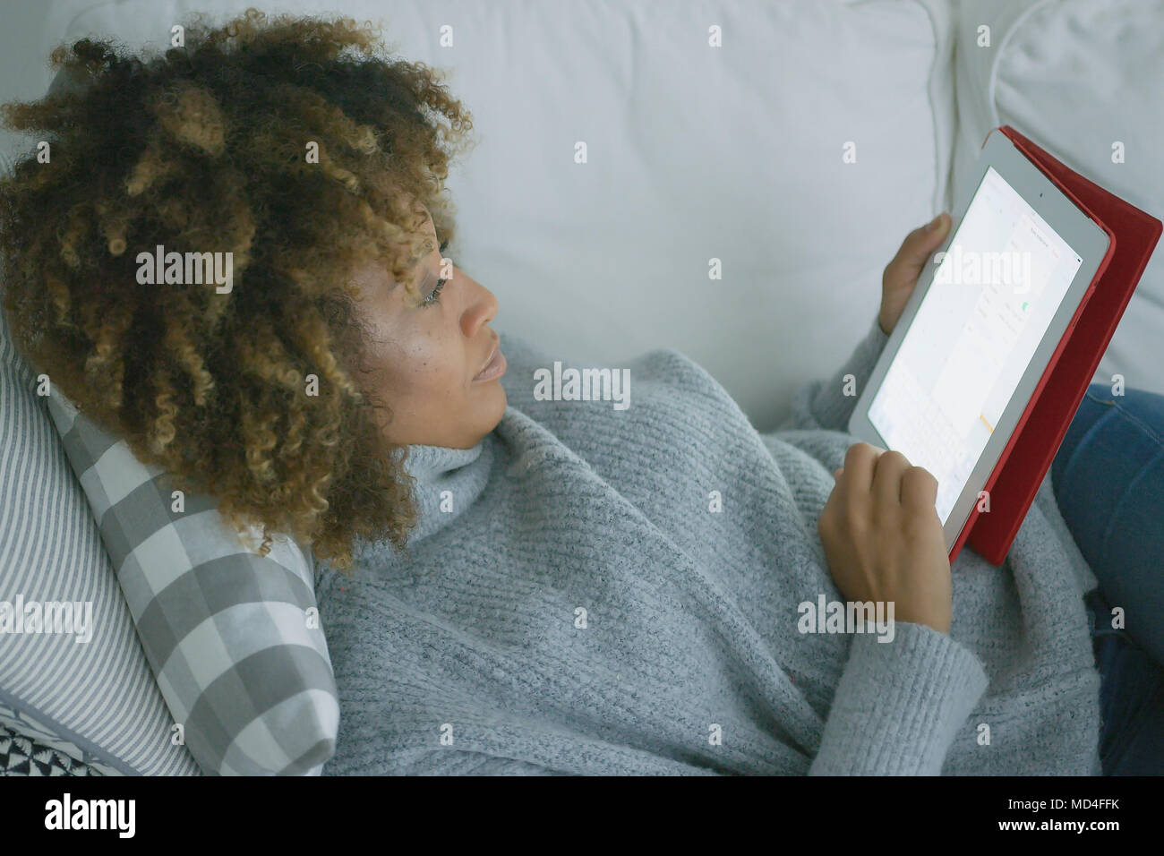 Casual woman spending time with tablet - Stock Image