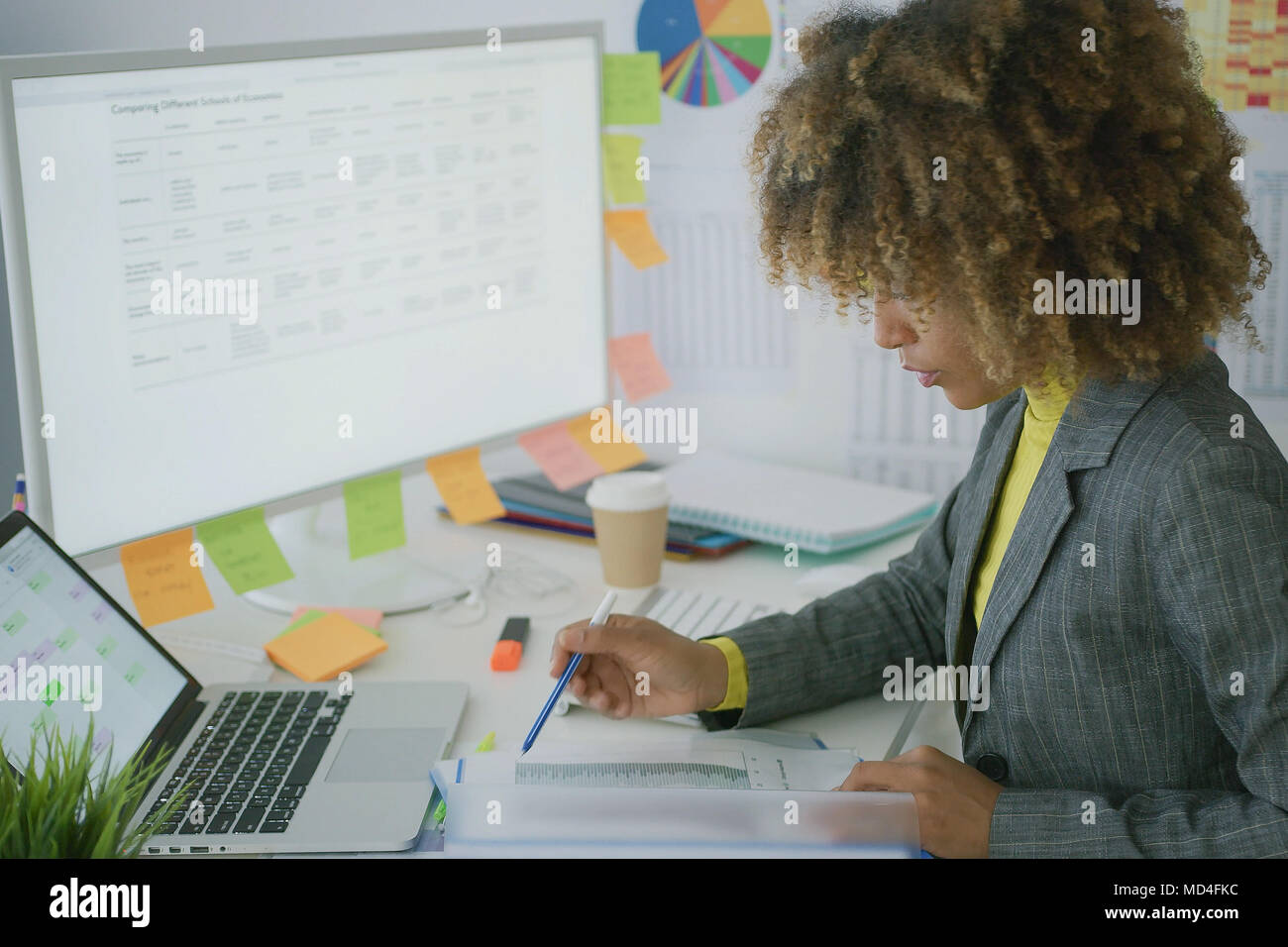 Young businesswoman working with documents - Stock Image