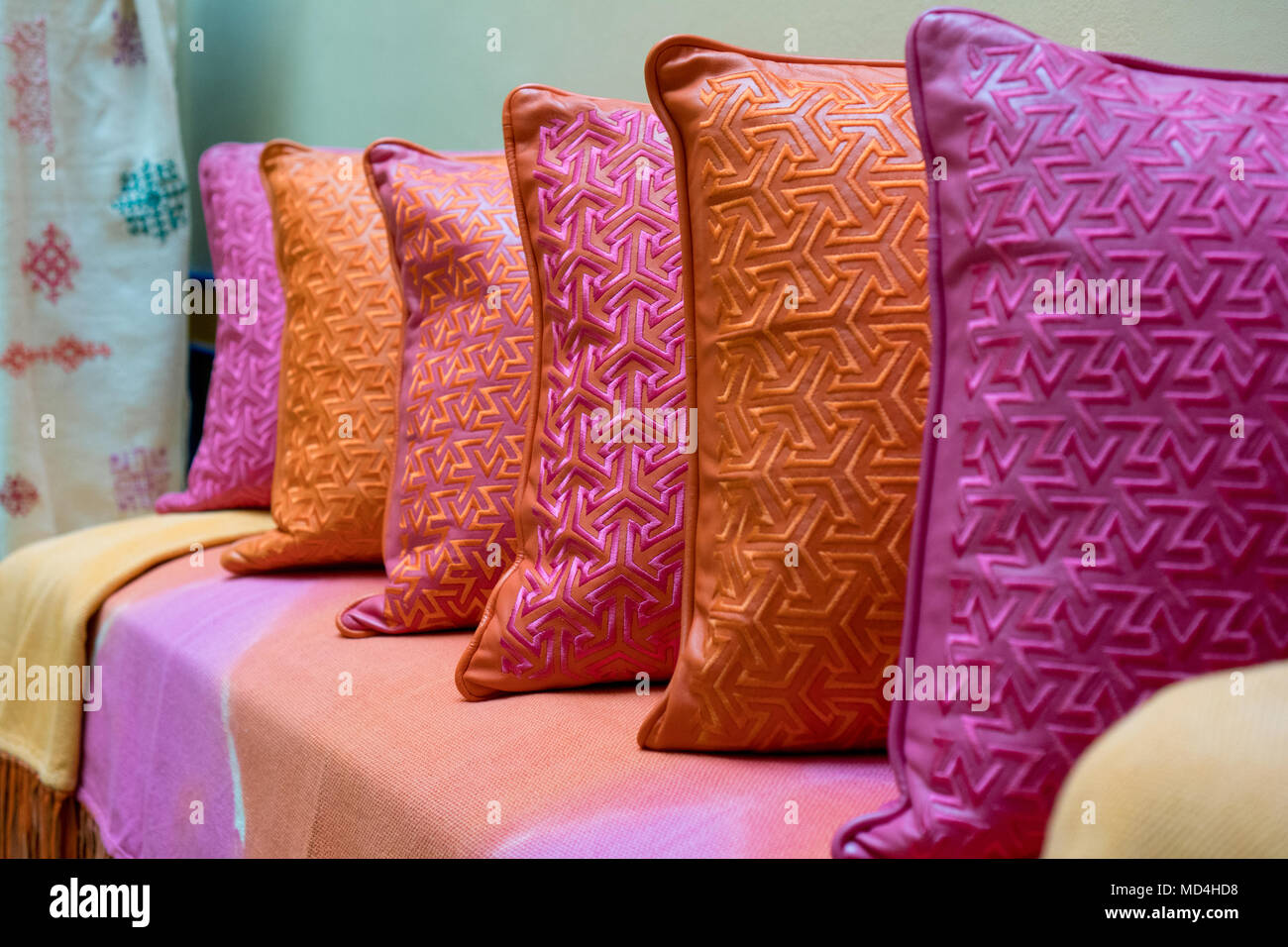 Red Orange And Magenta Decorative Pillows Arranged On A Couch For Living Room Decoration Stock Photo Alamy
