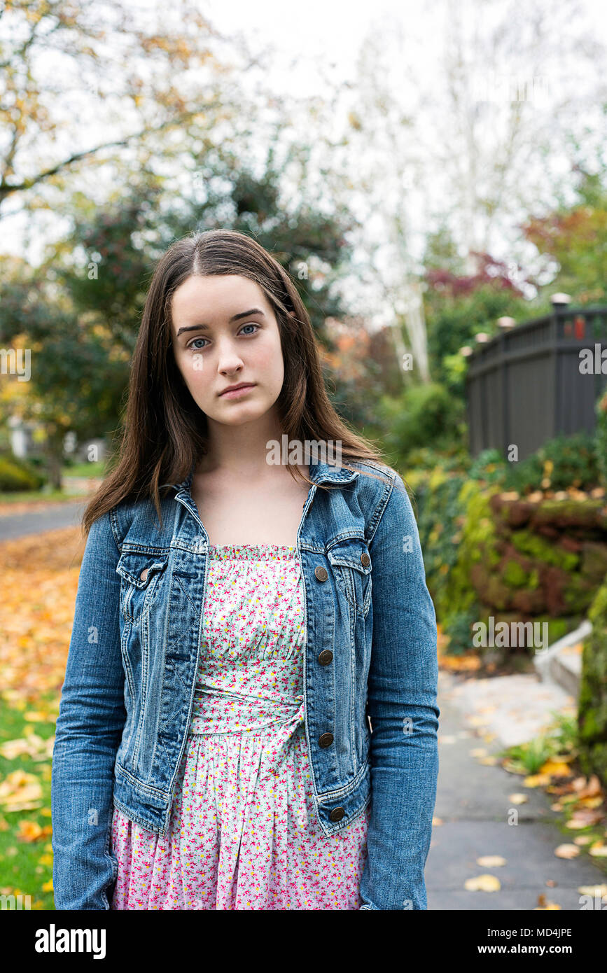 A teenaged girl (13 years old) looking at the camera with concern. - Stock Image