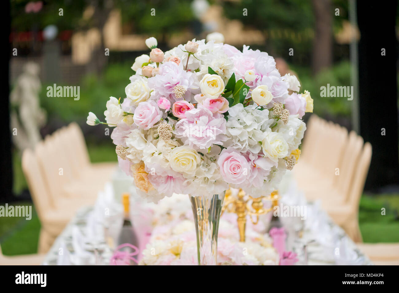 Wedding decoration with flowers on a table outdoors stock photo wedding decoration with flowers on a table outdoors junglespirit Images