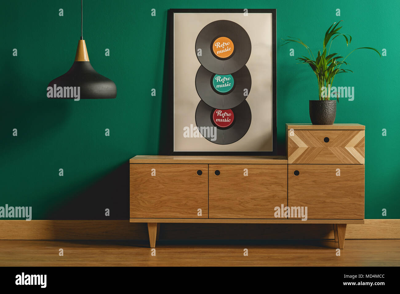 Close-up of a large framed poster with vinyl records leaning against ...