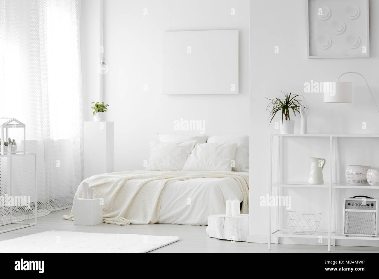 Cozy white bedroom interior with a king size bed, shelves ...