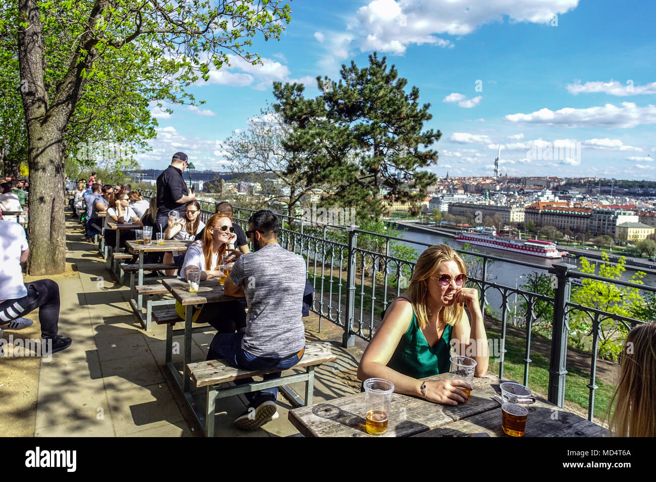 People at beer garden Letensky zamecek in Letna Park, Prague park Czech Republic Stock Photo