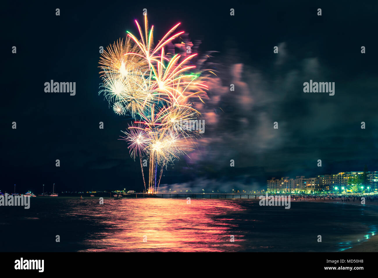 Fireworks display on New Year eve at Glenelg beach from jetty, South Australia - Stock Image