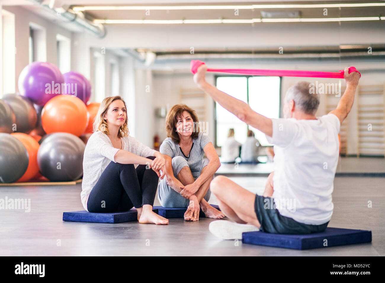 Senior physiotherapist working with a female patients. - Stock Image
