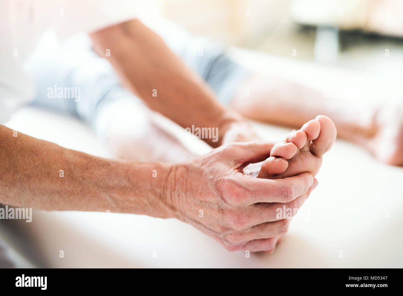 A physiotherapist working with a patient. - Stock Image