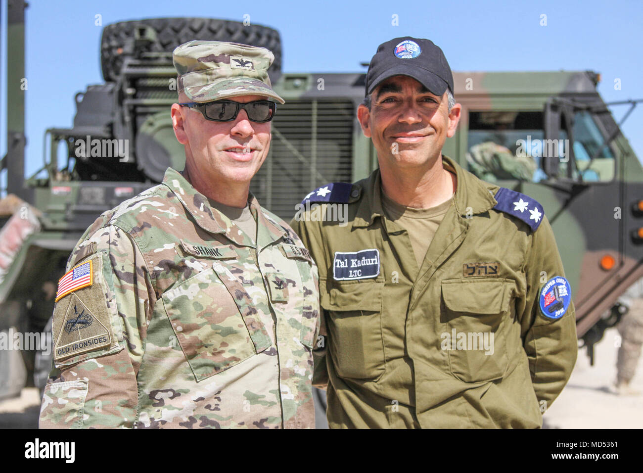 Col. David E. Shank, commander of the 10th Army Air and Missile Defense Command, takes a photo with Lt. Col. Tal Kaduri, head of cooperation for the Israel Air Defense Force, while visiting the 5th Battalion, 7th Air Defense Artillery area of operation during Juniper Cobra 18, here Mar. 14, 2018. Juniper Cobra 18 is designed to improve the shared defensive capabilities between the U.S. and Israel against any missile threats. - Stock Image