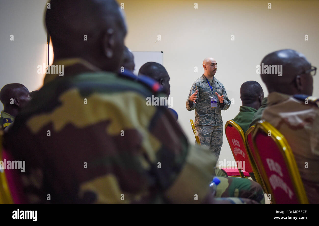 Chief Master Sgt. Ken Hauck, 48th Fighter Wing staff agencies superintendent, answers questions during an air and ground safety group discussion during African Partnership Flight Senegal at Captain Andalla Cissé Air Base, Senegal, March 20, 2018. APF Senegal involves approximately 40 U.S. Airmen from U.S. Air Forces in Europe and Air Forces Africa, the West Virginia Air National Guard, the 818th Mobility Support Advisory Squadron, and the Language Enabled Airman Program. (U.S. Air Force photo by Capt. Kay Magdalena Nissen) - Stock Image
