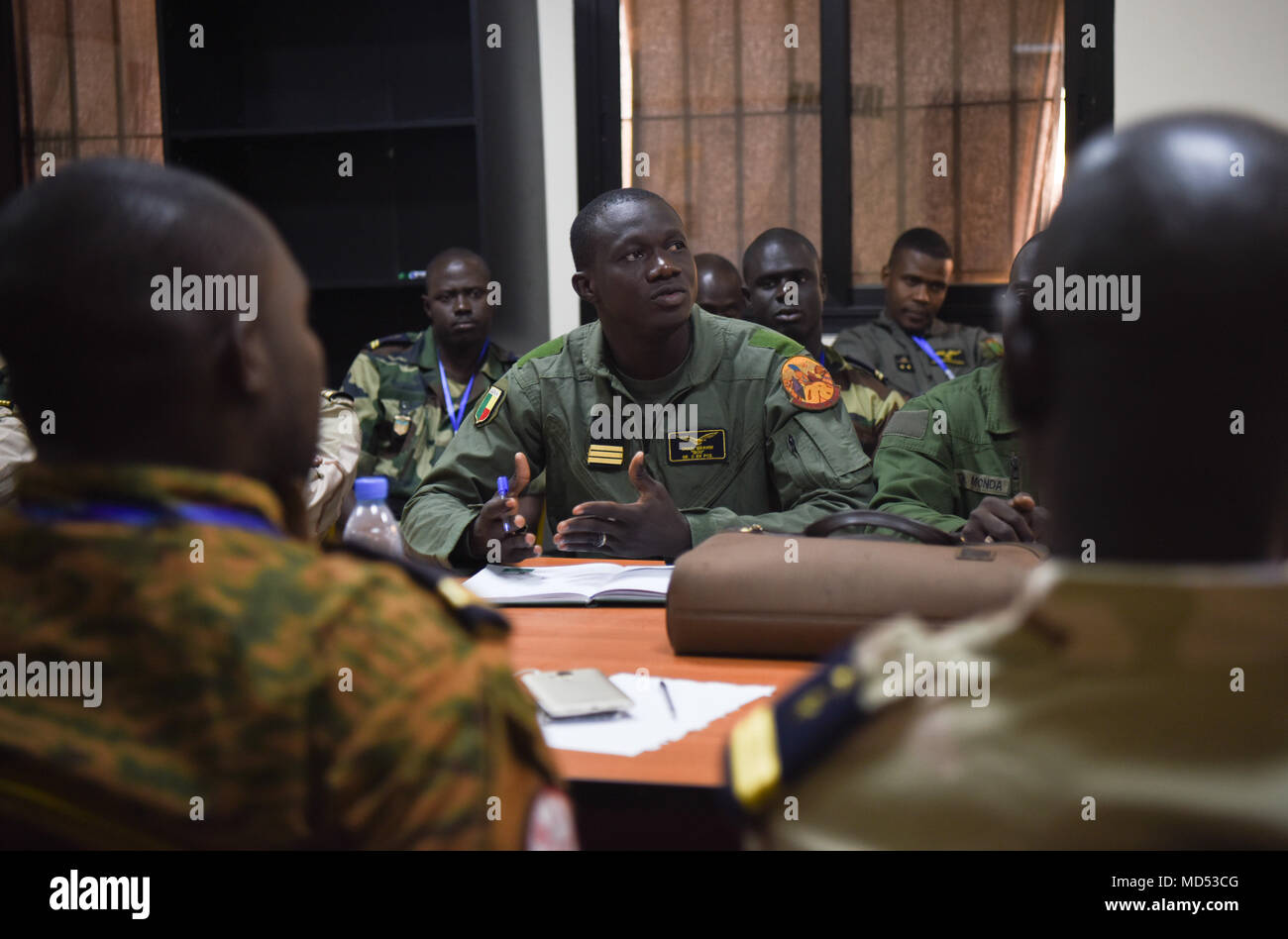 Benin helicopter pilot, Capt. Chabi Ibrahim, discusses safety in air operations during African Partnership Flight Senegal at Captain Andalla Cissé Air Base, Senegal, March 20, 2018. APF Senegal is a multilateral, military-to-military engagement emphasizing security assistance with African air forces. (U.S. Air Force photo by Capt. Kay Magdalena Nissen) - Stock Image