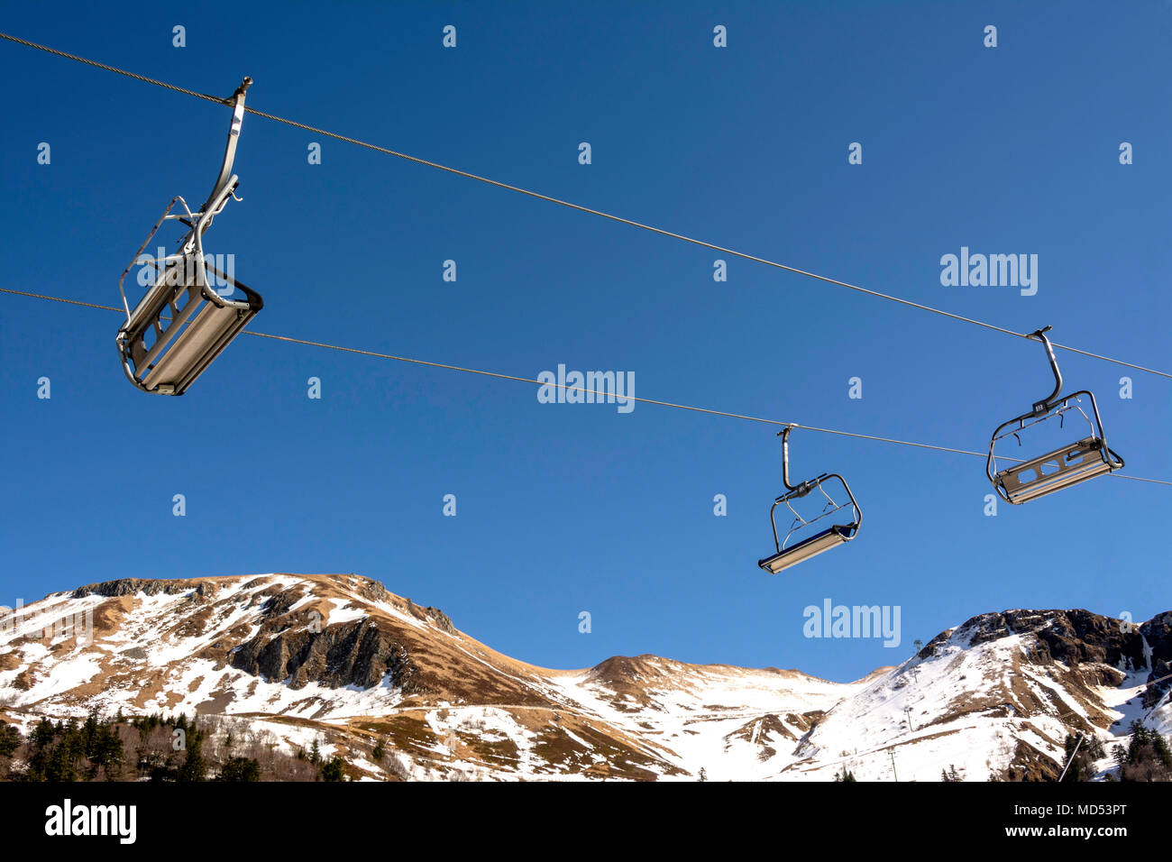 Chairlift and lack of snow in a ski resort of Auvergne, Auvergne, France - Stock Image