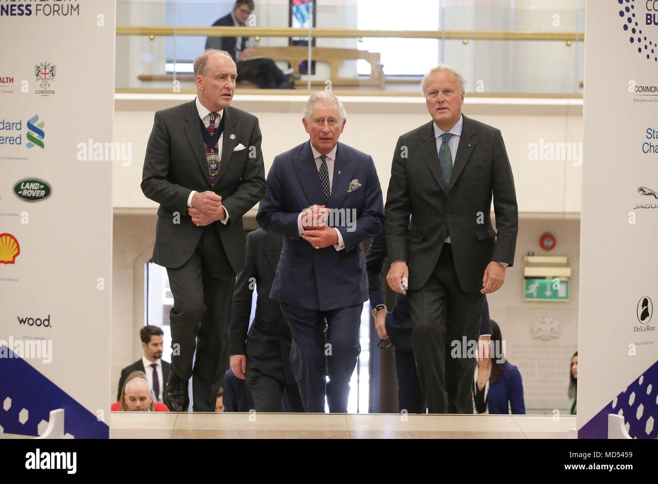 The Prince of Wales flanked by The Lord Mayor of London, Charles Bowman (left) and Chairman of the Commonwealth Enterprise and Investment Council, Lord Marland, arrives for a reception at the closing session of the Commonwealth Business Forum at the Guildhall in London, during the Commonwealth Heads of Government Meeting. - Stock Image