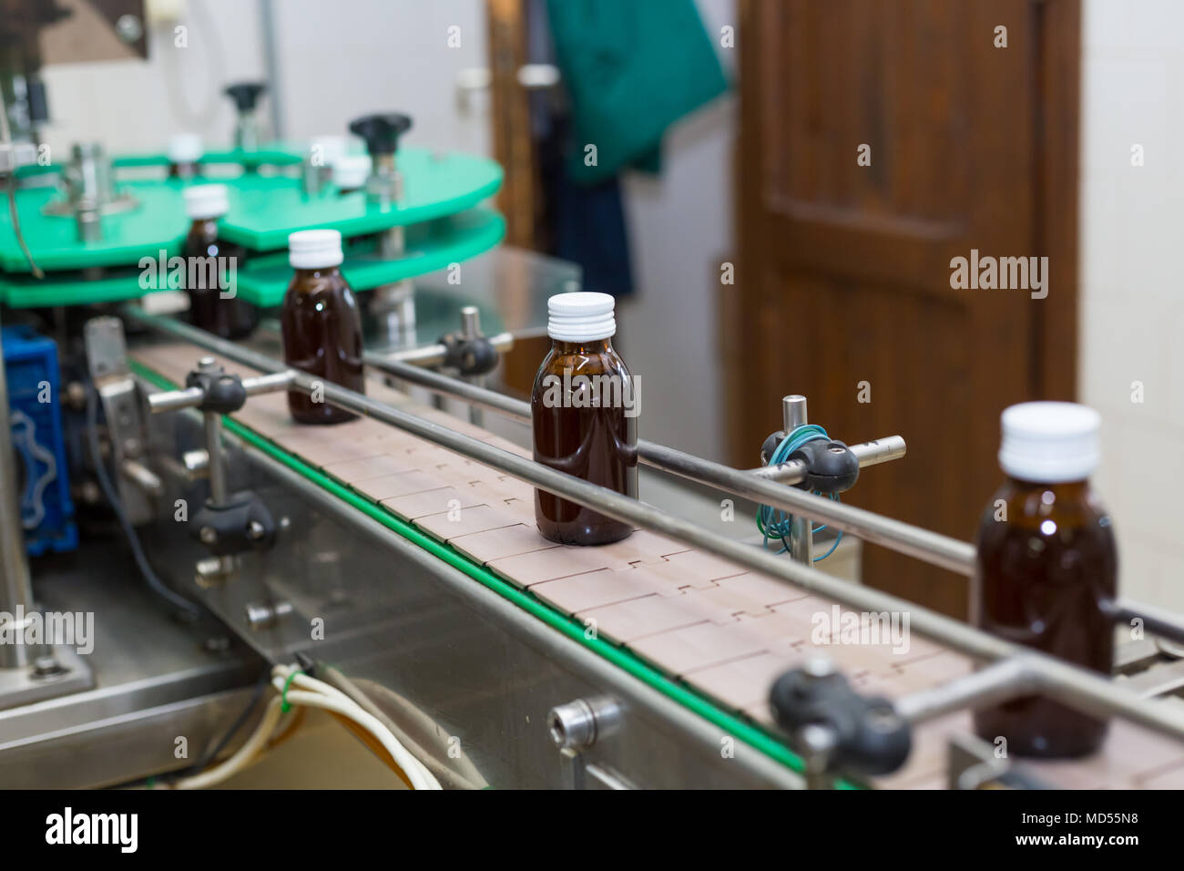 Pharmaceutical brown glass bottle production line. - Stock Image