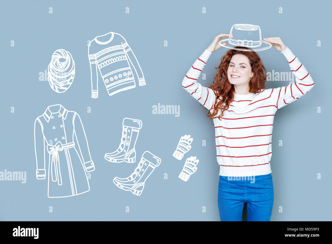 Positive shop assistant smiling while being at work - Stock Image