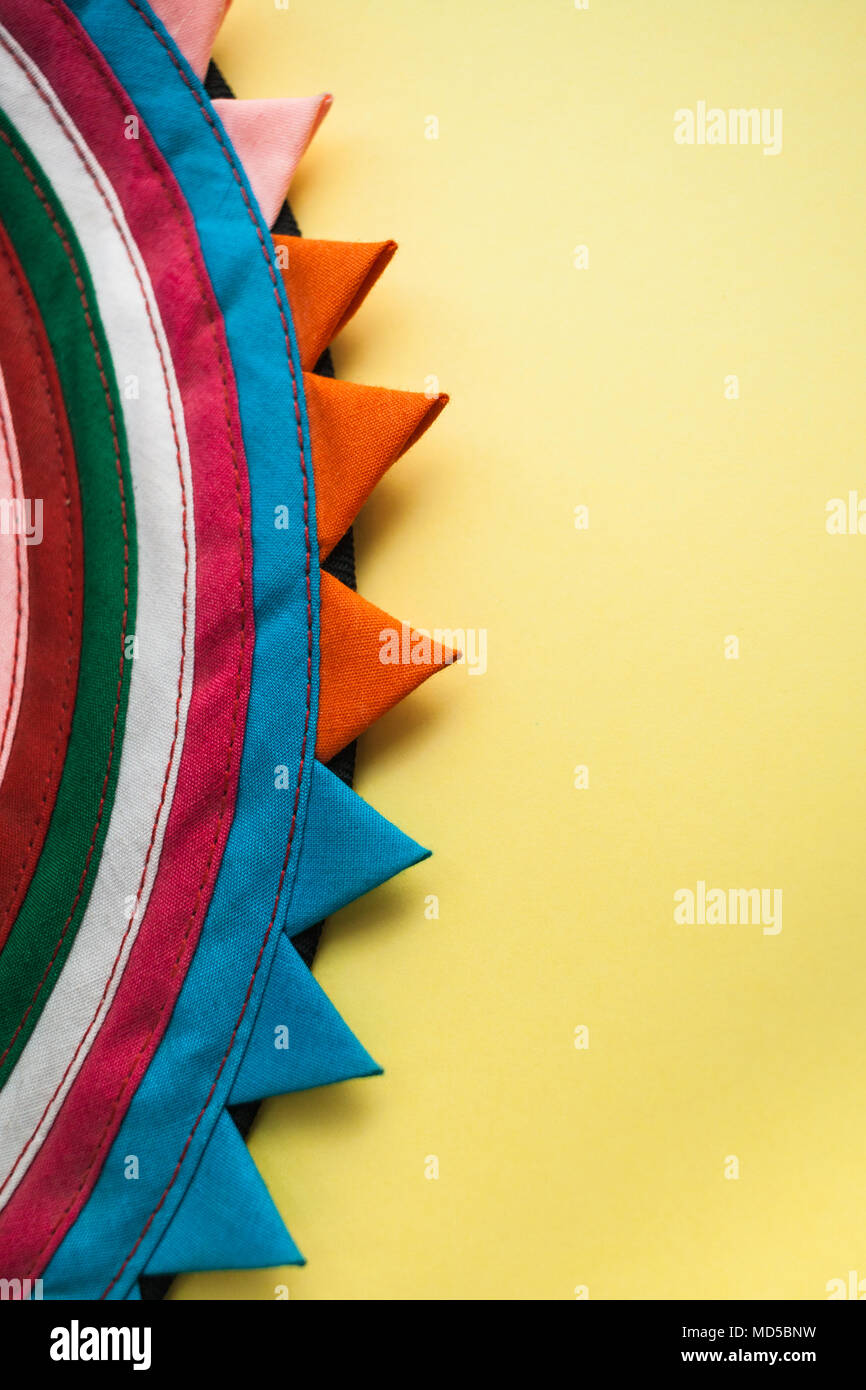 Circular Handmade Striped Cloth On The Left And Bright Pastel Yellow Background With Copy Space Right Stock Photo 180213205