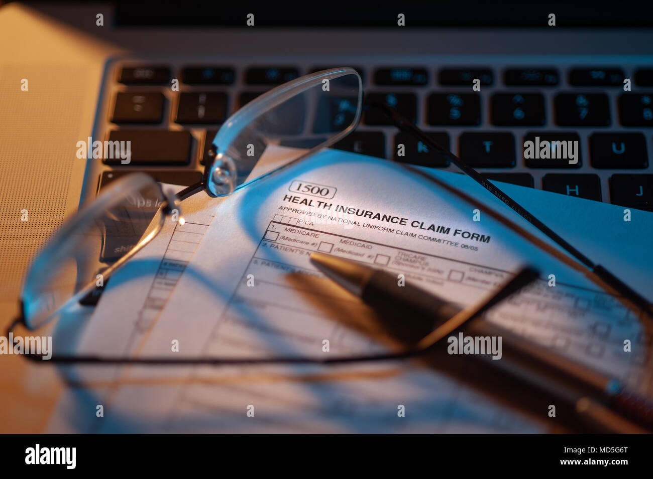 Filling out health insurance health form - Stock Image