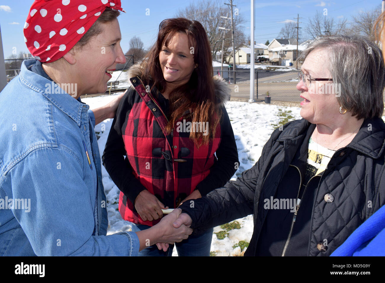 """Betty Wagner (center) and Brenda Corey (right) meet Angie Timan (left), event coordinator for the Rosie the Riveter Memorial Rose Garden Dedication ceremony in Bedford, Ind., March 21. Wagner and Corey are current Crane Army Ammunition Activity employees and carry on the legacy of the """"Rosies"""" who worked at the base during World War II and the post-war era. - Stock Image"""