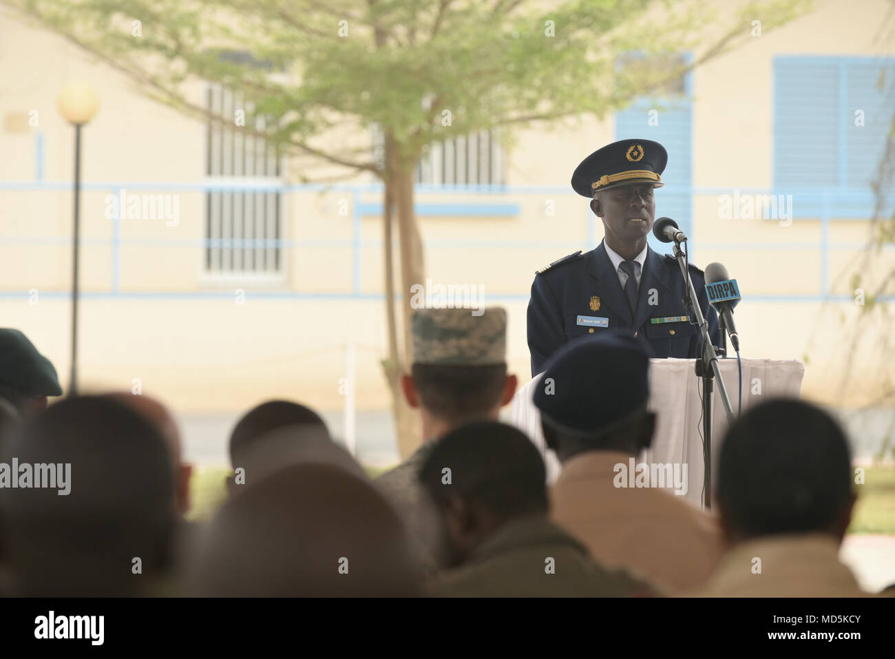 Senegalese Col. Boucar Sene, second in command of the Senegalese air force, speaks during the closing ceremony of African Partnership Flight Senegal at Captain Andalla Cissé Air Base, Senegal, March 23, 2018 The APF program is U.S. Air Forces in Africa's premier security cooperation program with African partner nations to improve professional military aviation knowledge and skills. (U.S. Air Force photo by Airman 1st Class Eli Chevalier) Stock Photo