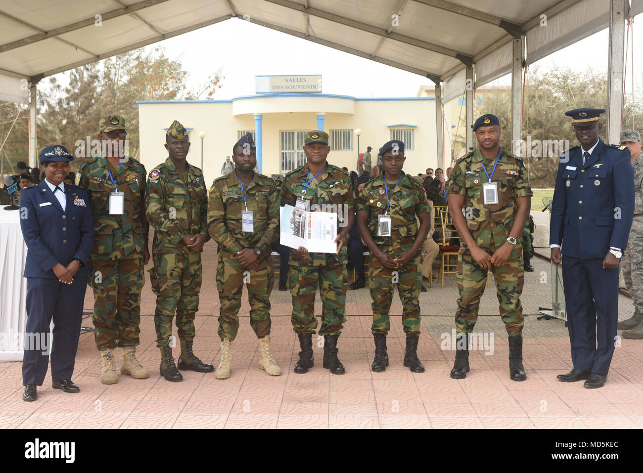 African Partnership Flight participants from Ghana pose for a photo after the closing ceremony for APF at Captain Andalla Cissé Air Base, Senegal, March 23, 2018. The event, co-hosted by the U.S. and Senegal, brought together ten nations to discuss tactics, techniques and procedures in the fields of aeromedical evacuation, casualty evacuation and air and ground safety. (U.S. Air Force photo by Airman 1st Class Eli Chevalier) - Stock Image
