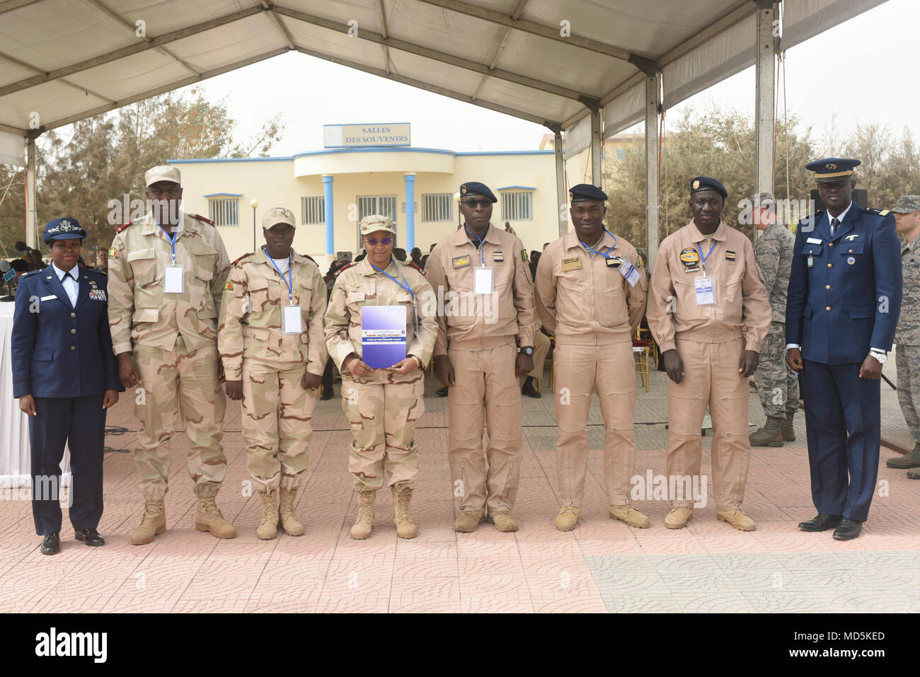 African Partnership Flight participants from Mali pose for a photo after the closing ceremony for APF at Captain Andalla Cissé Air Base, Senegal, March 23, 2018. Ten nations participated in the week-long event, which focused on aeromedical evacuation, casualty evacuation and air and ground safety. (U.S. Air Force photo by Airman 1st Class Eli Chevalier) - Stock Image
