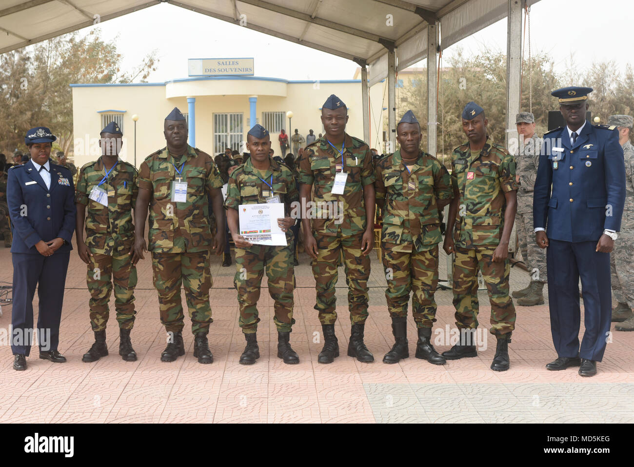 African Partnership Flight participants from Togo pose for a photo after the closing ceremony for APF at Captain Andalla Cissé Air Base, Senegal, March 23, 2018. The APF program is U.S. Air Forces in Africa's premier security cooperation program with African partner nations, with the goal of improving professional military aviation knowledge and skills. (U.S. Air Force photo by Airman 1st Class Eli Chevalier)  (U.S. Air Force photo by Airman 1st Class Eli Chevalier) - Stock Image