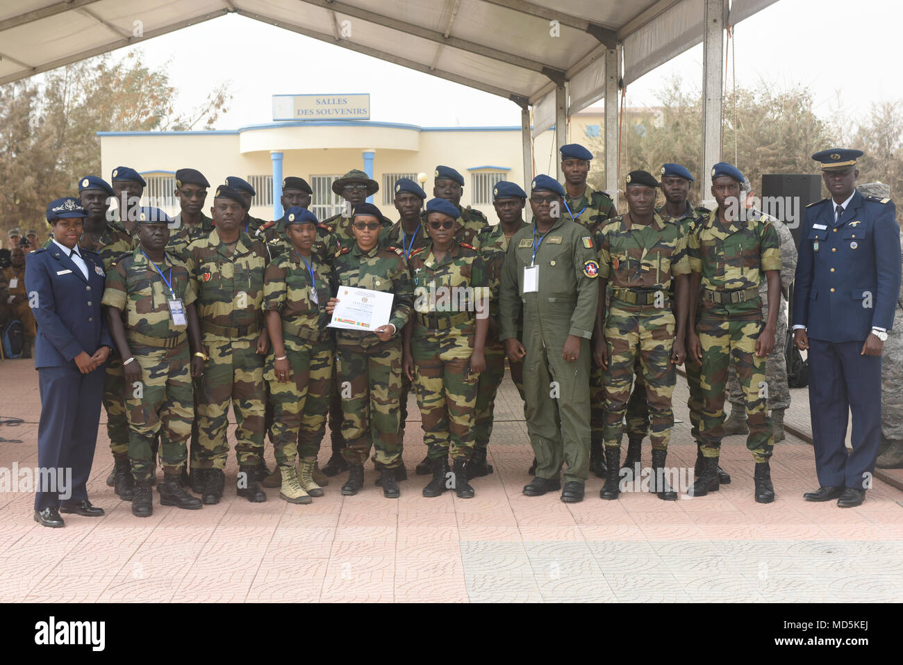 African Partnership Flight participants from Senegal pose for a photo after the closing ceremony for APF at Captain Andalla Cissé Air Base, Senegal, March 23, 2018. The marks the end of the 12th APF held since the program began in 2012, and the second co-hosted by Senegal. (U.S. Air Force photo by Airman 1st Class Eli Chevalier)  (U.S. Air Force photo by Airman 1st Class Eli Chevalier) - Stock Image