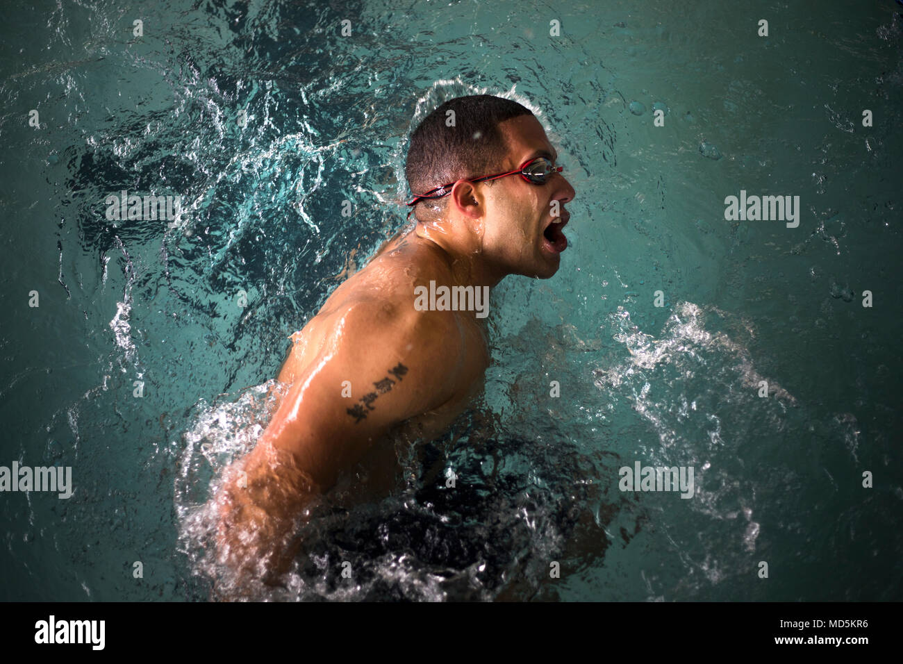 U.S. Marine Corps Gunnery Sgt. Alexis Padilla takes a breath before kicking off the pool wall to breaststroke his remaining 25 meters during the 2018 Marine Corps Trials swimming competition. The Marine Corps Trials promotes recovery and rehabilitation through adaptive sport participation and develops camaraderie among recovering service members (RSMs) and veterans. It is an opportunity for RSMs to demonstrate their achievements and serves as the primary venue to select Marine Corps participants for the DoD Warrior Games. (U.S. Marine Corps photo by Sgt. Matthew Callahan) Stock Photo