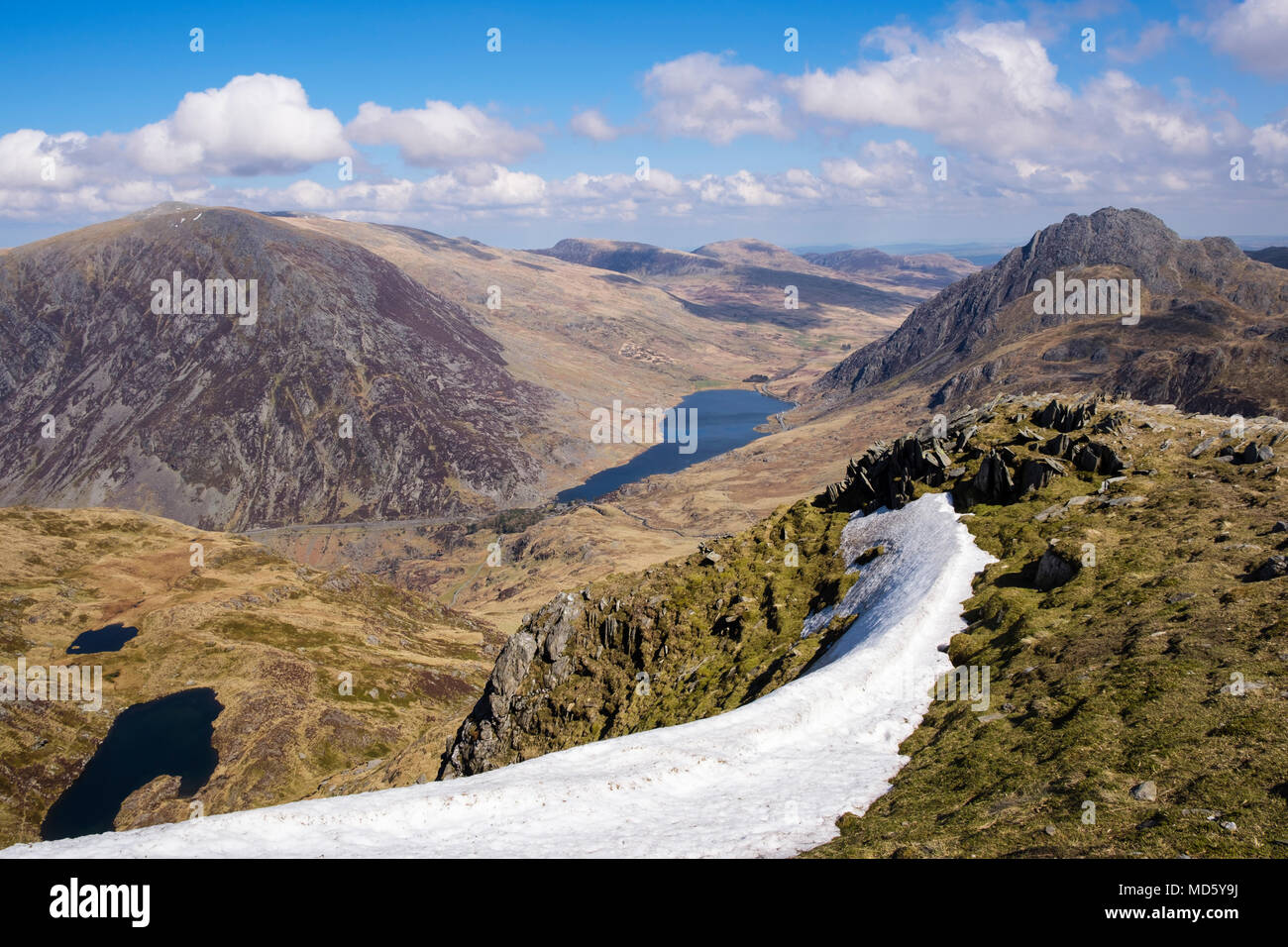 Scenic landscape seen from Y Garn ridge above Ogwen Valley in mountains of Snowdonia National Park in early spring. Ogwen, North Wales, UK, Britain - Stock Image