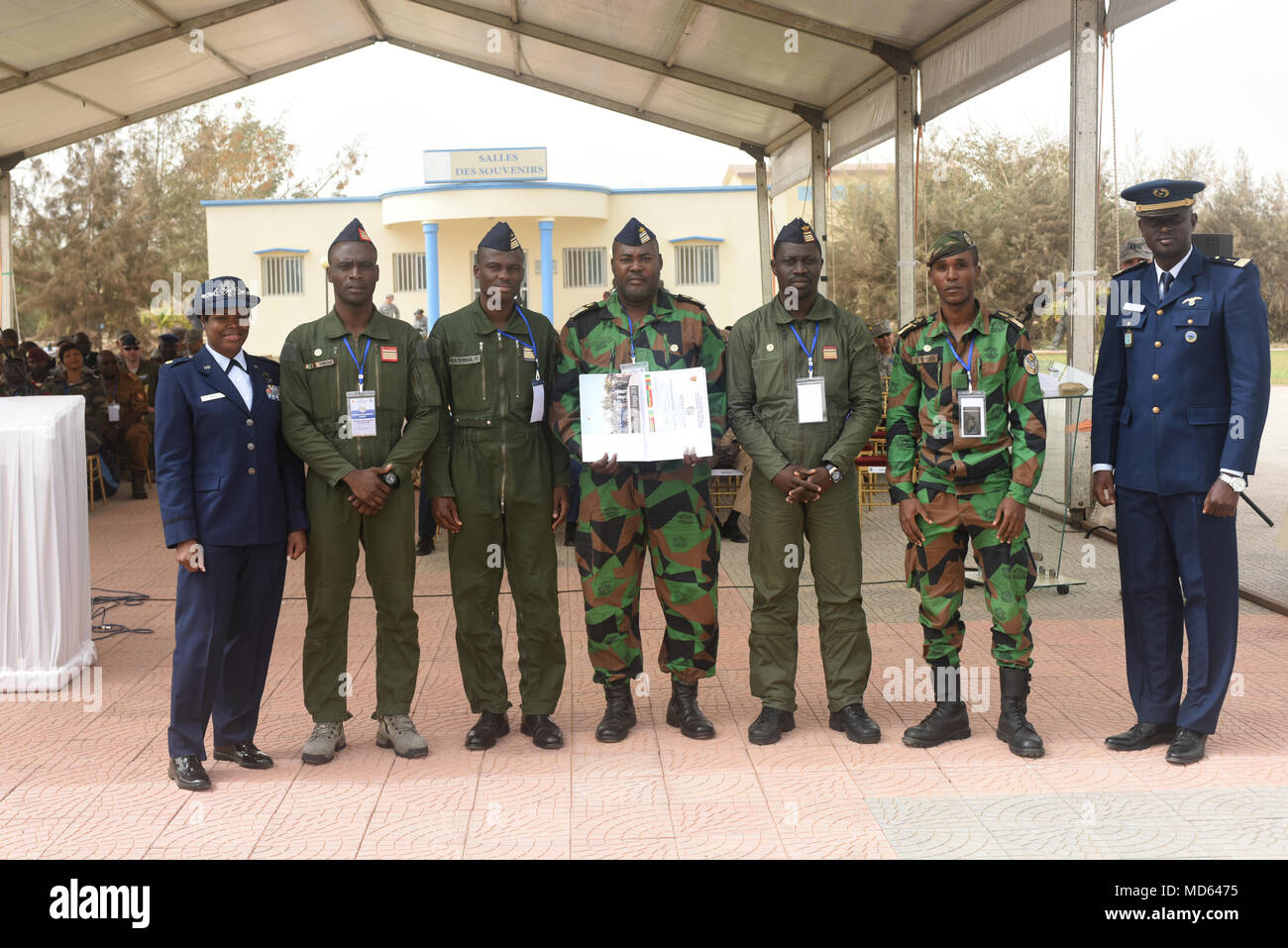 African Partnership Flight participants from Côte d'Ivoire pose for a photo after the closing ceremony for APF at Captain Andalla Cissé Air Base, Senegal, March 23, 2018. The purpose of APF Senegal is to conduct multilateral, military-to-military engagements and security assistance with African air forces. (U.S. Air Force photo by Airman 1st Class Eli Chevalier)  (U.S. Air Force photo by Airman 1st Class Eli Chevalier) - Stock Image