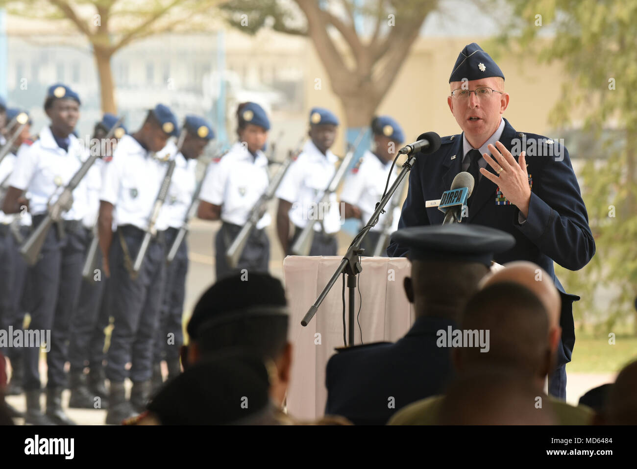 U.S. Air Force Lt. Col. Andrew Allen, chief of global health engagements branch, U.S. Air Forces in Europe and Air Forces Africa, speaks during the closing ceremony of African Partnership Flight Senegal at Captain Andalla Cissé Air Base, Senegal, March 23, 2018. The purpose of APF Senegal is to conduct multilateral, military-to-military engagements and security assistance with African air forces. (U.S. Air Force photo by Airman 1st Class Eli Chevalier) - Stock Image