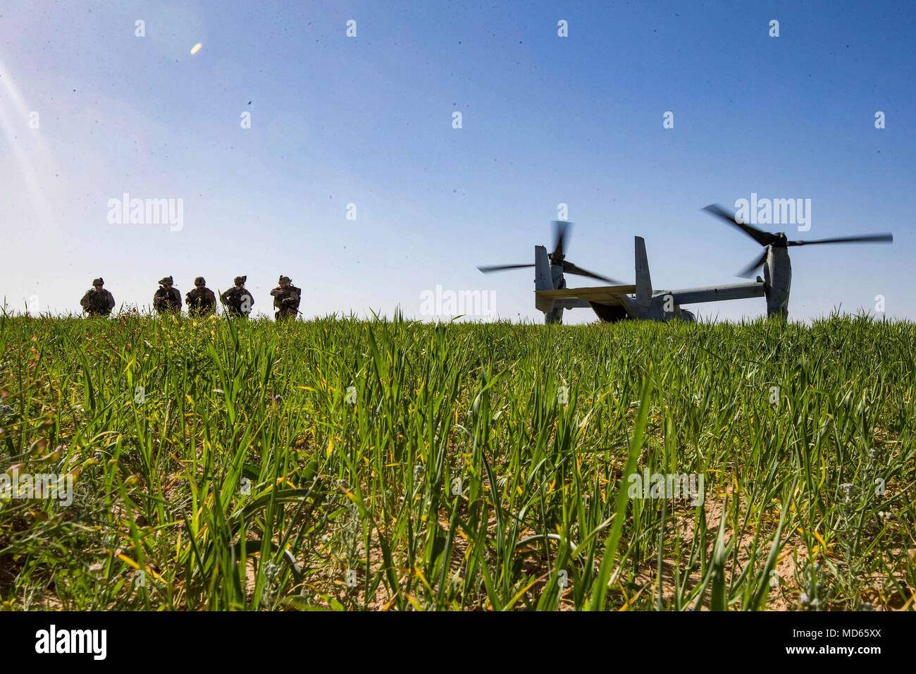HAIFA, Israel (March 14, 2018) U.S. Marines assigned to the Tactical Recovery of Aircraft Personnel (TRAP) team, 26th Marine Expeditionary Unit (MEU), arrive in a landing zone of an MV-22B Osprey aircraft to conduct a simulated search mission, in Haifa, Israel, March 14, 2018. Juniper Cobra is a computer assisted exercise conducted through computer simulations focused on improving combined missile defense capabilities and overall interoperability between the U.S. European Command and Israel Defense Force. (U.S. Marine Corps photo by Lance Cpl. Tojyea G. Matally/Released) Stock Photo