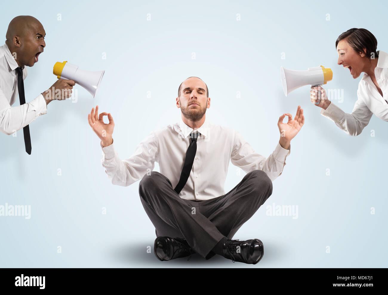 Impassive businessman despite the screams - Stock Image