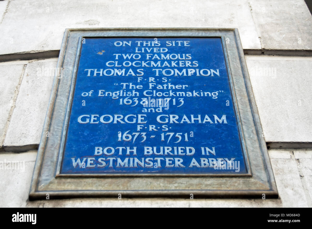 blue plaque marking the site of the homes of two prominent clockmakers, thomas tompion and george graham, fleet street, london, england - Stock Image