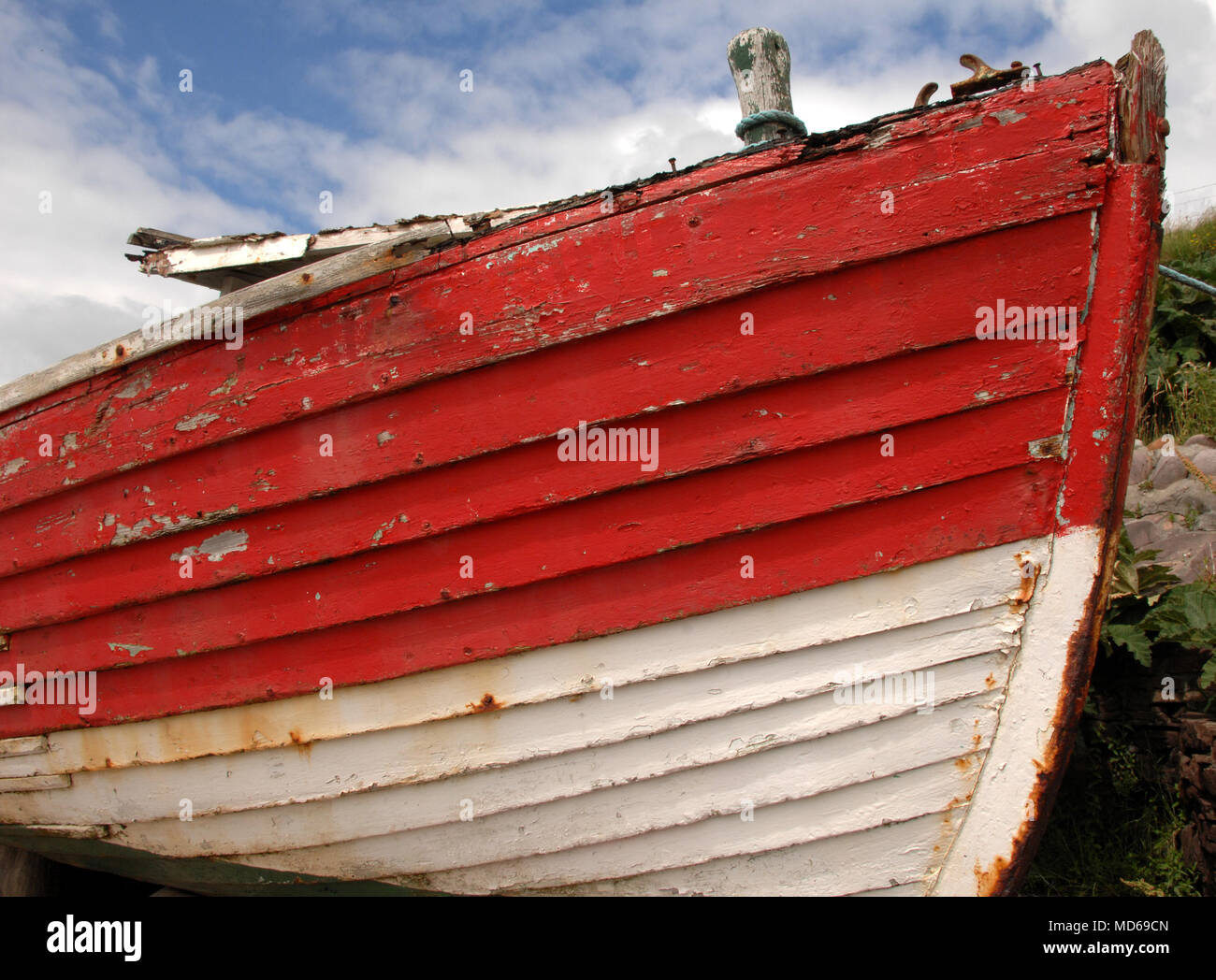 Red and White Rowing Boat moored on the Westcoast of Ireland - Stock Image