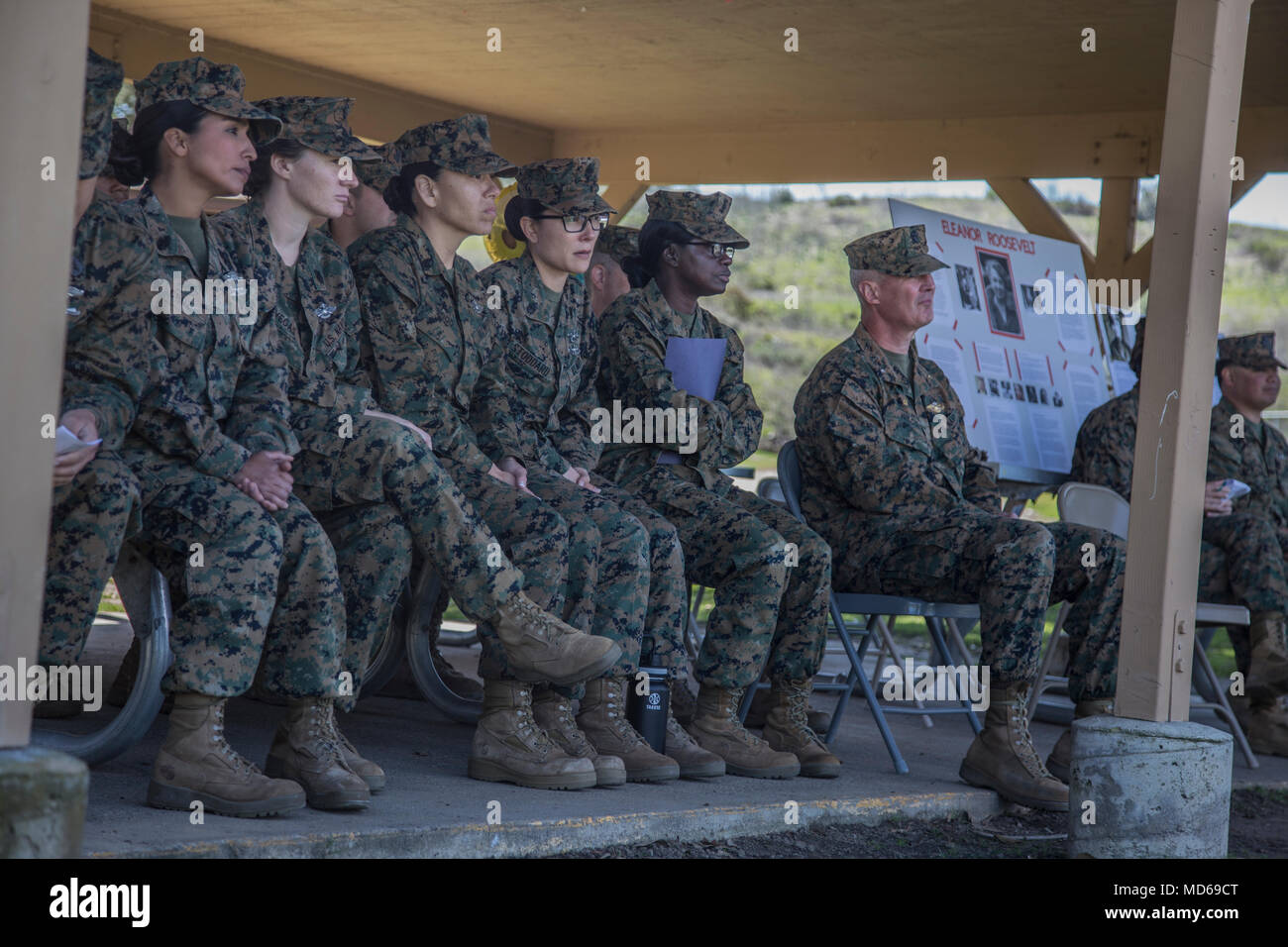 U.S. Sailors with 1st Medical Battalion, 1st Marine Logistics Group, listen to retired Marine Maj. Kathleen Ables about her experiences in the military as a woman during the Womens History Month Celebration event at Camp Pendleton, Calif., March 27, 2018. During the speech, she spoke about the challenges faced by woman in the military during the mid 1900's. (U.S. Marine Corps photo by Pfc. Timothy Shoemaker) - Stock Image
