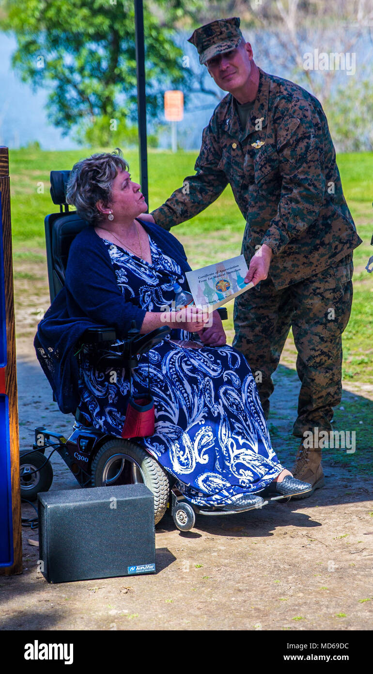 Retired U.S. Marine Maj. Kathleen Ables, an activist for women's equality, receives a certificate of appreciation during Women's History Month Celebration event at Camp Pendleton, Calif., March 27, 2018. The Sailors of 1st Marine Logistics Group honor Kathleen Ables for her service and dedication to the Marine Corps. (U.S. Marine Corps Photo by Lance Cpl. Quentarius Johnson) - Stock Image
