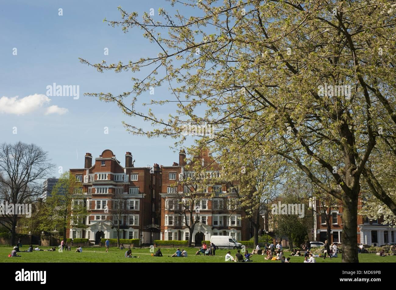 People having enjoying the summer sunshine on chiswick green 2018 - Stock Image