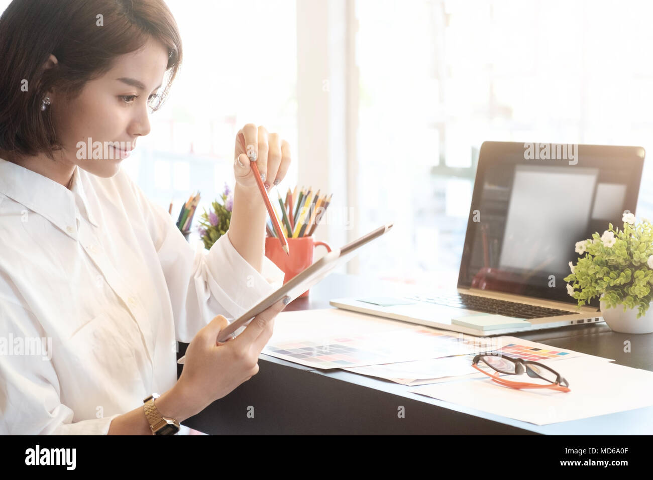 Cropped shot of Graphic designer woman creative on artist workplace. Stock Photo