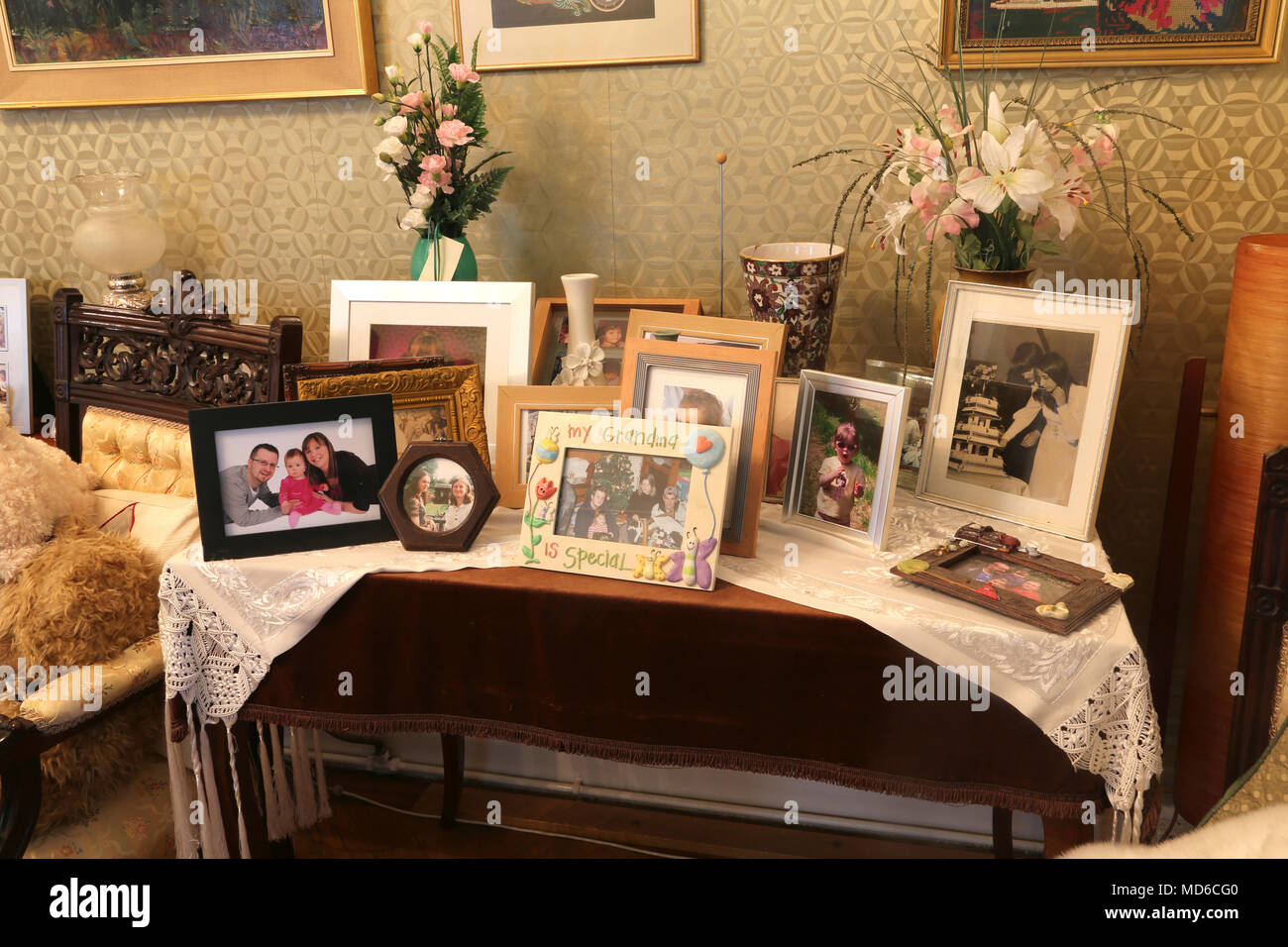 Family Photos on Side Table in Home Surrey England - Stock Image