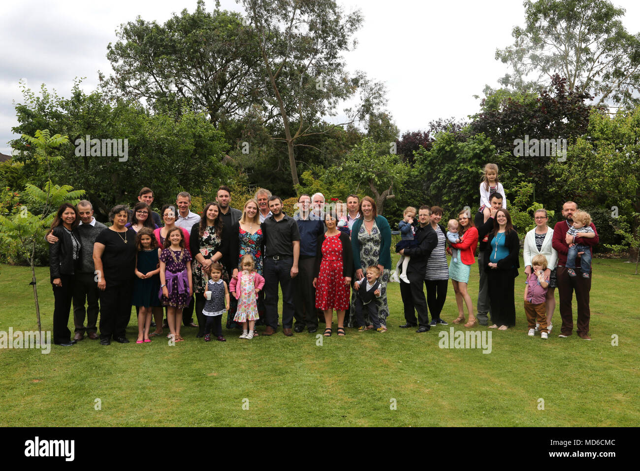 Large Group of People Extended Family in Garden Surrey England - Stock Image